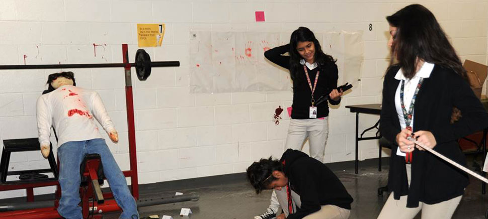 Grand Prairie students inspect the crime scene and gather data.