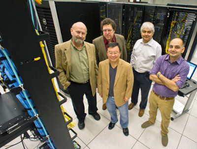 Members of the UT Arlington high energy physics group are: (clockwise from the left) Professors Andrew White, Andrew Brandt, Kaushik De, Associate Professor Amir Farbin, and Professor Jaehoon Yu.