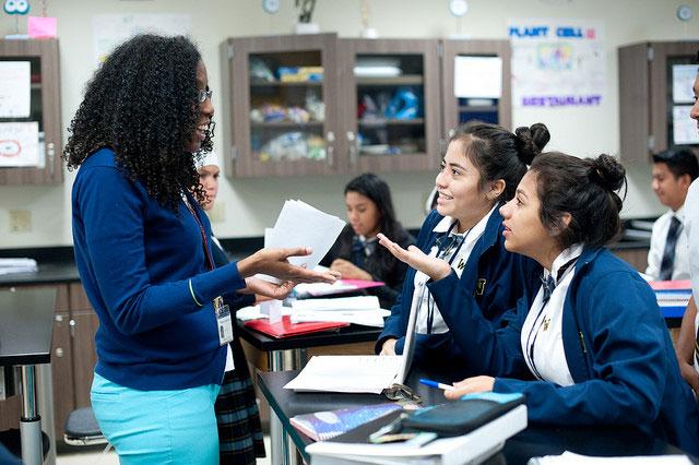 Dr. Rhonda Hyde, ninth-grade biology teacher, and ninth graders, Yulissa Alvarez and Rachel de-la Paz at Uplift Williams Preparatory. Photo by Brandon Thibodeaux.