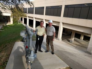 Michael DeArmond, account manager for Atmos, and Robert Shaddox, project specialist for Atmos, at the new gas meter at Terminal B. (Photo by Nicholas Sakelaris)
