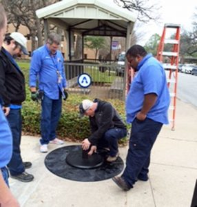 Maintenance workers install of the donated NRG Street Charge stations at UT Arlington. (Photos courtesy the University of Texas at Arlington)
