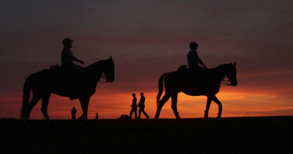 Colombian policemen patrol on horseback near Cartagena's historic walls. REUTERS/Joaquin Sarmiento