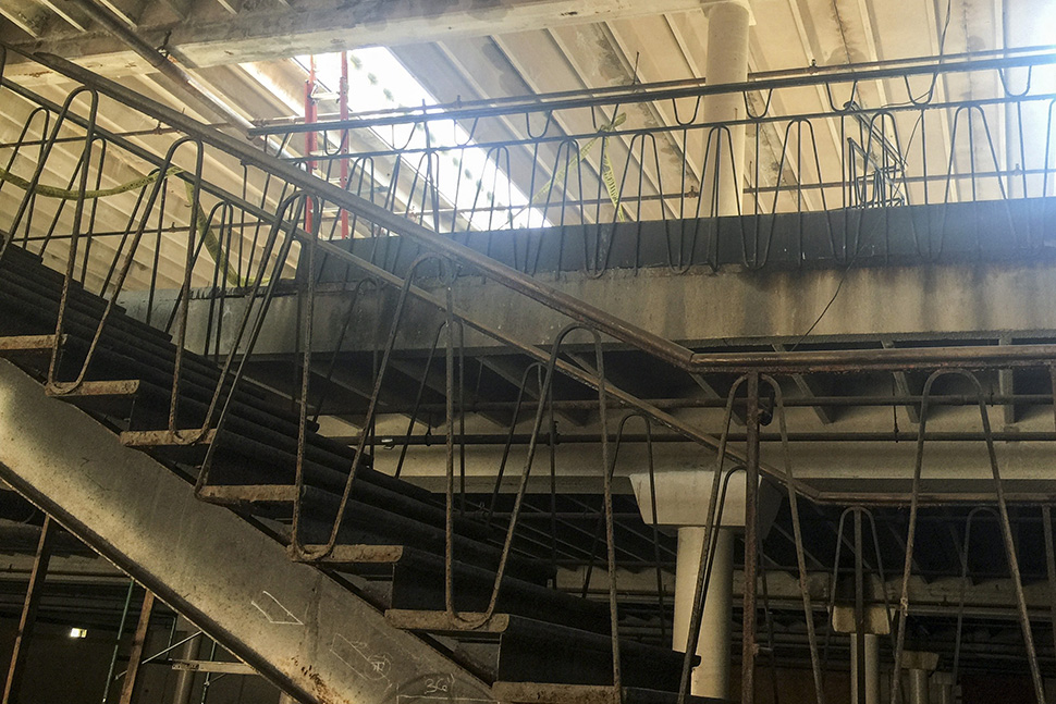 The original banisters will be restored by metal workers. (Dallas Innovates staff photo)