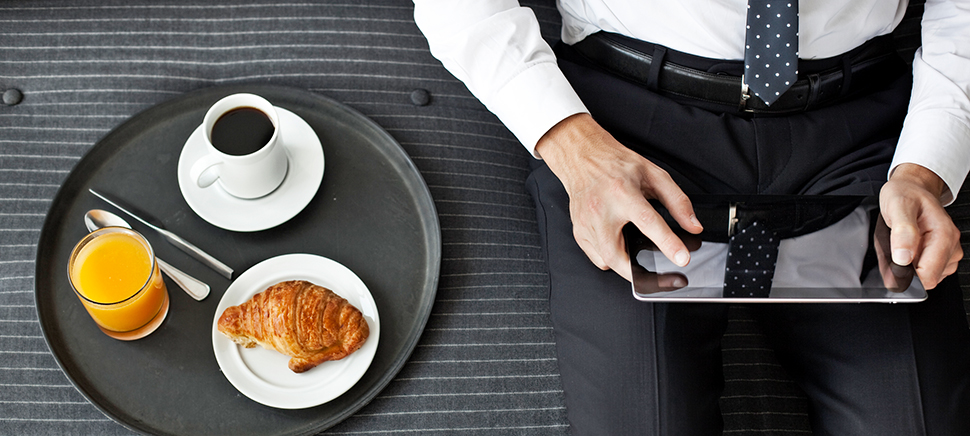 Business man sitting and using a tablet