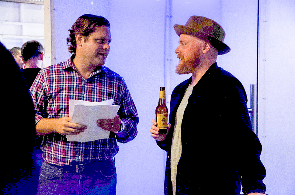 Trey Bowles, Dallas Entrepreneur Center Co-founder and CEO greets people as they enter the Unplugged event. Here, with Matt Alexander.