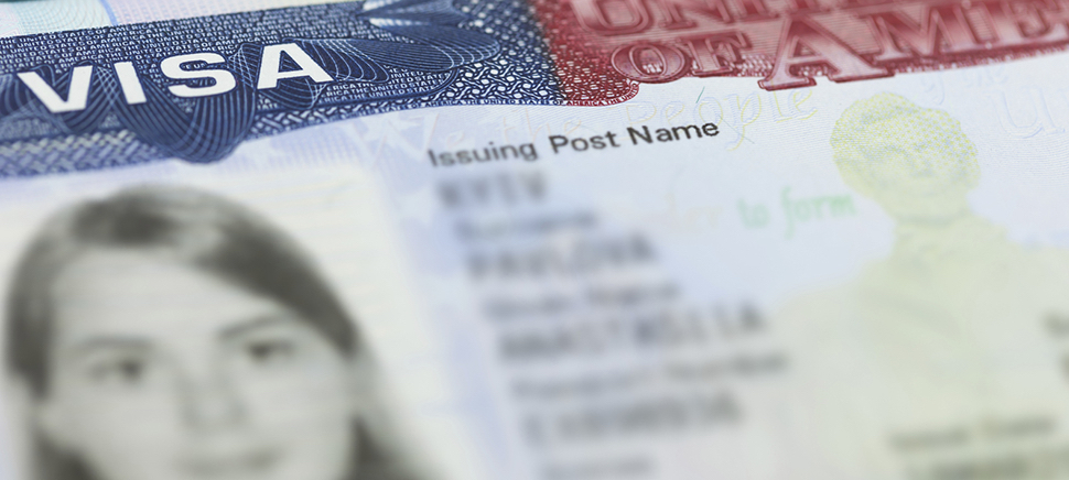 The American Visa in a passport page (USA) background.