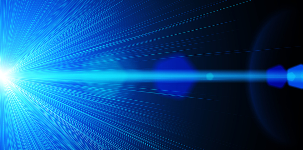 Stock image of A blue bright laser ray on black background